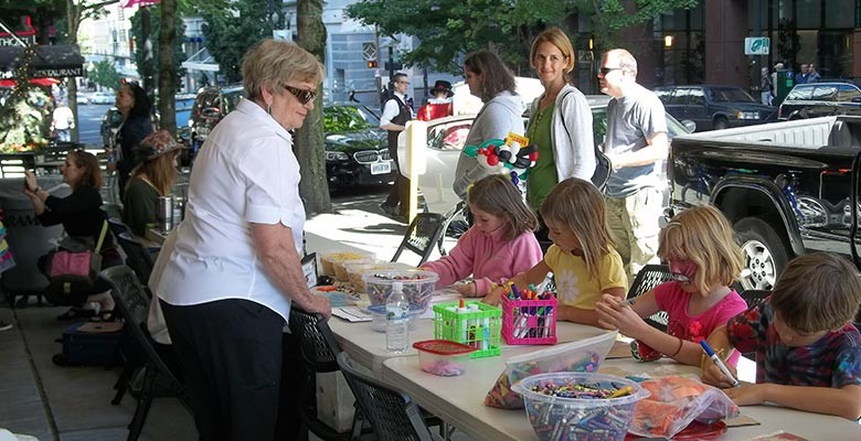 Photo: Children enjoying the kids crafts area at Summer Arts on Main Street.