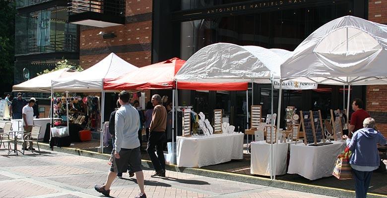 Photo: Vendor booths at Summer Arts on Main Street offering handmade crafts.