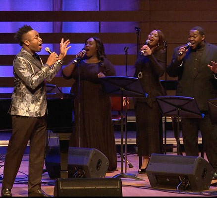 We Shall Overcome image - Photo of Damien Sneed and choir singing