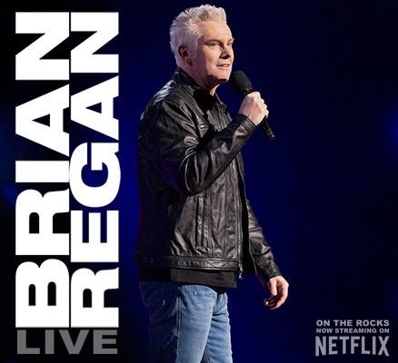 Photo: Brian Regan performing, holding microphone | Text: Brian Regan Live